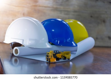 Engineer, electrician and worker 's helmet color as White, Blue and Yellow , PPE  (Personal Protective Equipment) very importance for health protection. Safety at work concept