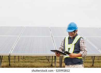 engineer or electrician working on maintenance equipment at industry solar power; engineer using driller working on Wrench tightening solar mounting structure of photovoltaic panel