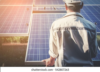 engineer or electrician working on replacement solar panel at solar power plant; working on repair solar panel to swap panel