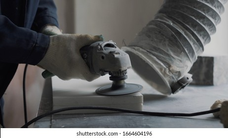 Engineer engraver cleans the surface of the stone plate for further processing