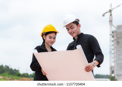 Engineer with equipment at construction site outdoors  work