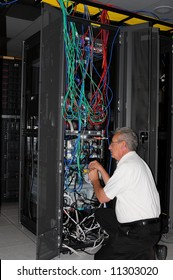 An engineer examining machine in computer room data center