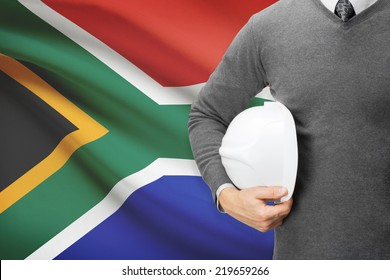 Engineer with flag on background  - South Africa