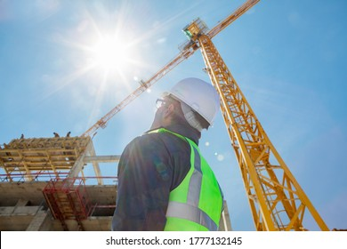 engineer foreman architect worker with hard hat working on construction site