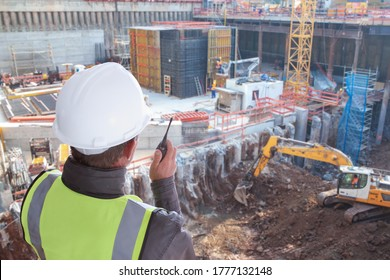 engineer foreman architect worker with hard hat working on construction site communication with walkie talkie