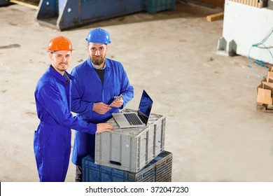 Engineer and foreman in factory.