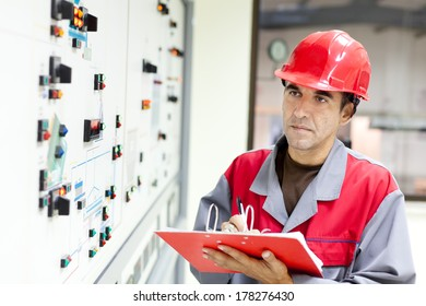 Engineer in the front of the control panel