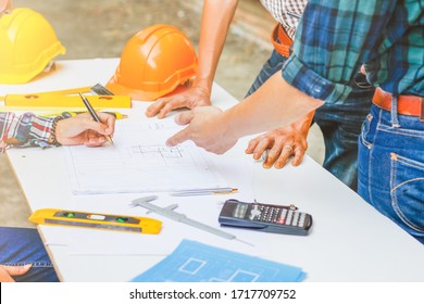 The engineer is giving advice and consulting with the designer to find out the construction site where the engineer will have to construct the project. Consultation between engineers and designers