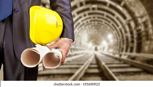 Jefe y empleado images stock photos vectors shutterstock engineer hand holding yellow helmet for workers security and blueprint paper plan against the background of malvernweather Images