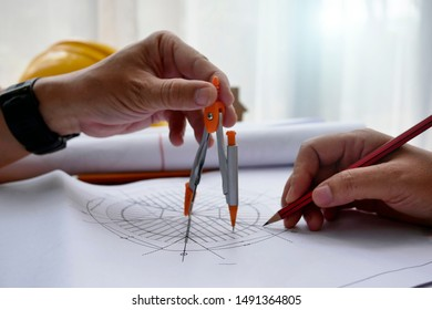 engineer hand sketching a construction project