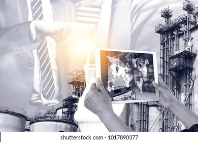 Engineer hand using tablet with supply chain logistic monitoring system software and smart factory industry 4th iot , digital manufacture. Double exposure of bump hand business successful.