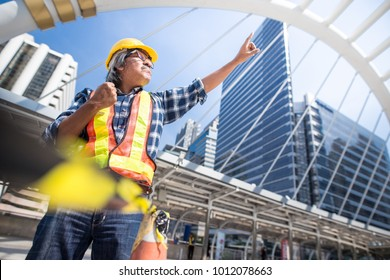 Engineer hands up in construction site