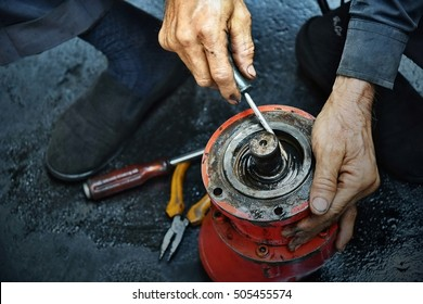 Engineer Hands;  man hands working on hydraulic cylinder engine stuff