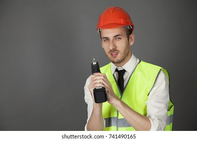 engineer in hard hat with screwdriver