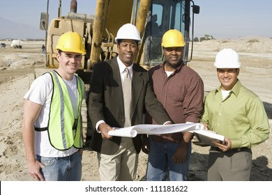Engineer holding blueprint at construction site