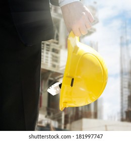 Engineer holding helmet