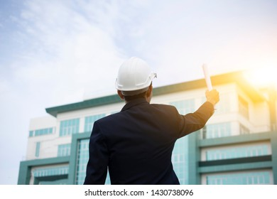 Engineer Holding paper plan and building Sky Background