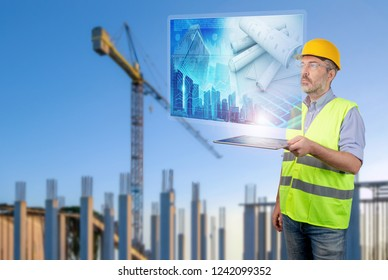 engineer holding a tablet displaying construction plans in costruction site