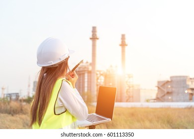 Engineer Industrial workers with  walkie-talkie and laptop working in a power plant