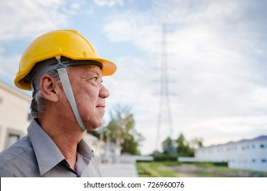 Engineer inspecting the high voltage power grid