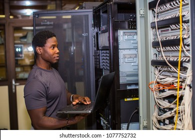 Engineer inspecting a rack
