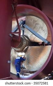 engineer inspecting ship propeller