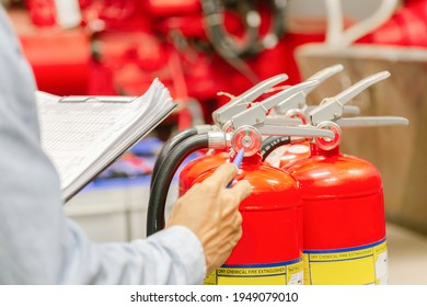 Engineer inspection Fire extinguisher and fire hose,Ready to use in the event of a fire.Safety first concept.