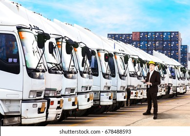 Engineer inspector standing over trucks in a row with Container background