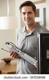 Engineer Installing Digital TV Device