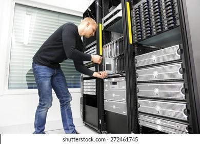 IT engineer installs blade server in datacenter