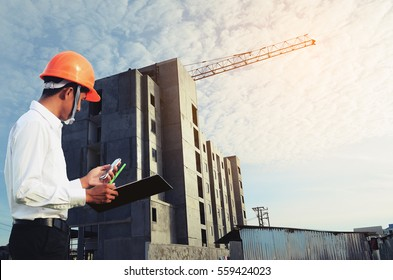 Engineer  with instruction, surveying  building-site,