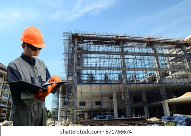 Engineer with instruction, surveying building-site