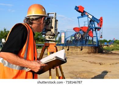 An engineer - land surveyor at work on an European oil field