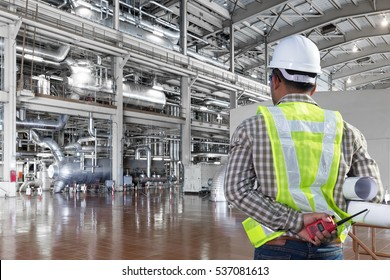 Engineer looking a boiler equipments and machinery in a modern thermal power plant industry