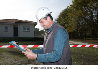 Engineer looking at his tablet at a construction site