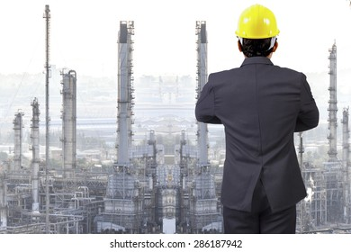 Engineer looking at oil refinery petrochemical industrial plant
