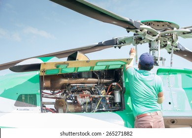 Engineer maintaining a helicopter Engine