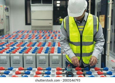 The engineer is Maintenance and checking of the battery storage system