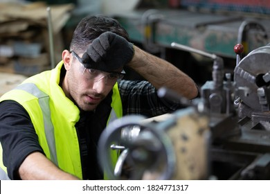 engineer man or factory worker feeling tired for working on the machine in factory