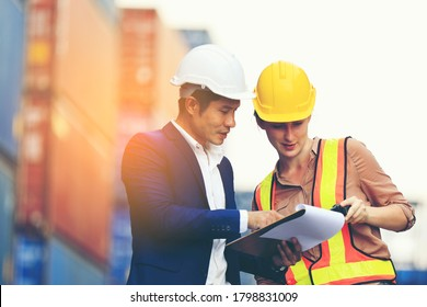 Engineer man, Foreman manager,in hardhat with Female foreman worker working in the construction container yard, Industrial Container yard for Logistics oversea import export shipping business.