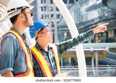 Engineer man and worker visit construction site for looking to process of building work.