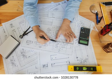 Engineer man working in the office, Drawing the construction project. Top view