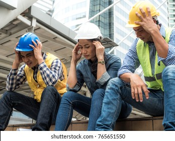 Engineer manager group is very sad Sit down disappointed with the erroneous work, Anxiety concept