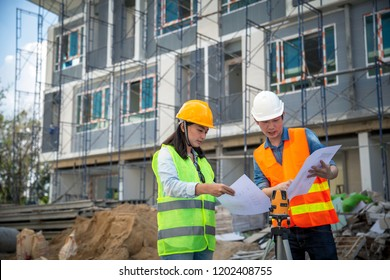 Engineer manager inspects construction sites and checking blueprints at building townhome project