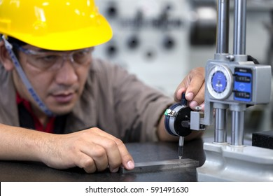 Engineer measure Inspection product with vernier height gage.