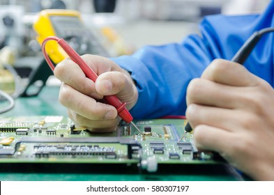 engineer measuring multimeter panel board