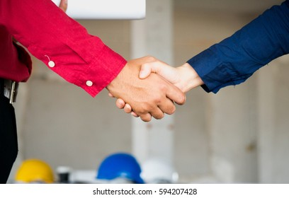 Engineer meet and greet with colleague and shake hand