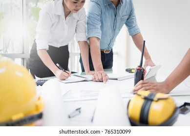 Engineer meeting in modern office with Architecture Interior Designer. Discussion to architectural project and Construction. Progress of Figures denoting of Accounting and Financial with partner
