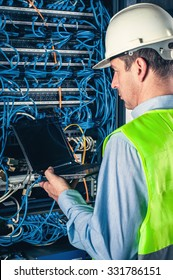 engineer in network server room solving problems