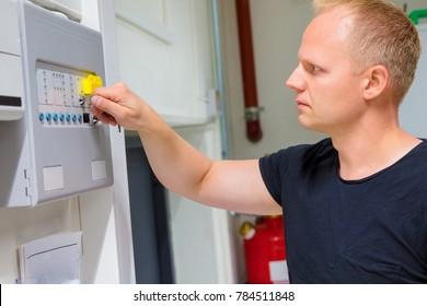 IT Engineer Opening Fire Panel In Server Room